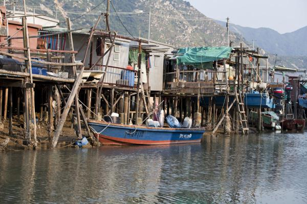 Boat docked at a house on stilts |  | 香港