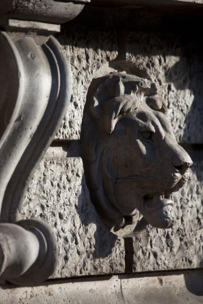 Lion head sculpted on a wall of a building on Andrássy út | Andrássy út | Hungary