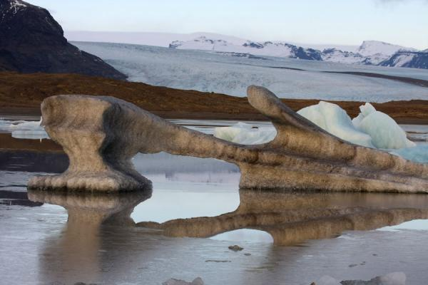 Picture of Fjallsárlón Glacier Lake (Iceland): Iceberg reflected in the freezing waters of Fjallsárlón