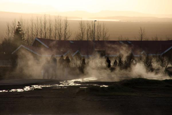 People walking near the steam coming from the earth at Geysir | Geysir | Iceland
