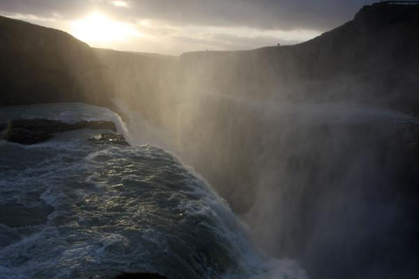 Picture of Gullfoss (Iceland): Sunlight piercing through the fine wall of water spray at Gullfoss