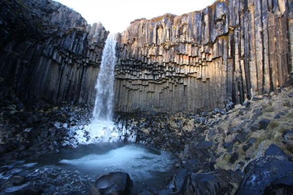 Picture of Skaftafell (Iceland): Water coming down into an icy pond at Svartifoss waterfall