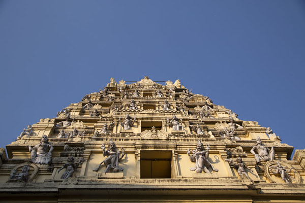 Looking up the tower over the entrance to the Bull Temple with sculpted Hindu deities | Bull Temple | India