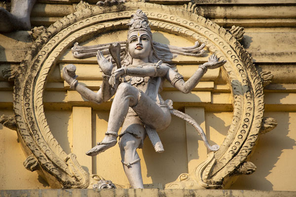 Picture of Four-armed Hindu deity Vishnu sculpted on the tower standing over the entrance to the Bull Temple - India - Asia