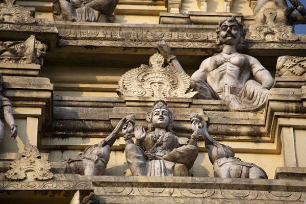 Picture of Hindu deities sculpted out of the tower standing over the entrance to the Bull Temple - India - Asia