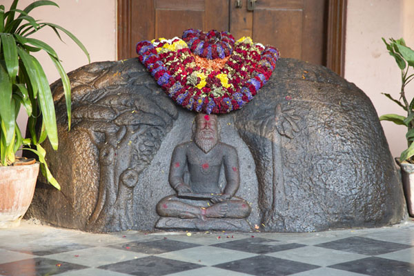 Picture of Flowers adorning a statue hewn from rock at an adjacent temple - India - Asia