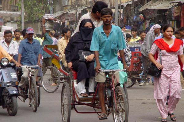 Picture of Cycle rickshaw in New Delhi traffic