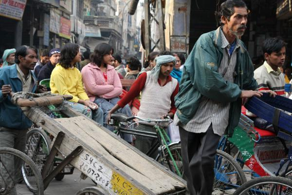 Picture of Chawri Bazaar (India): Man trying to cross a busy street in Chawri Bazaar