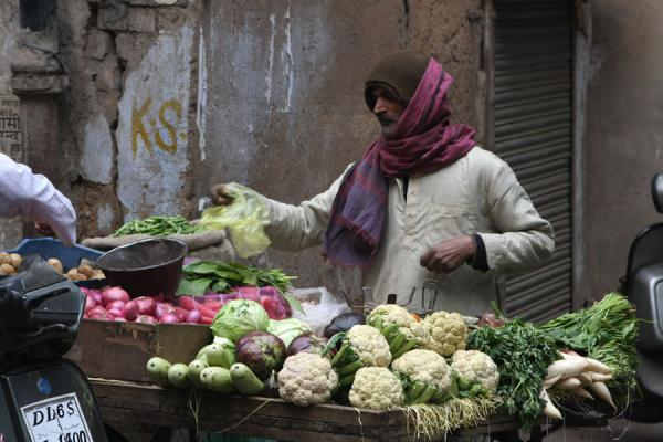 Selling vegetables from a stall | Chawri Bazaar | India