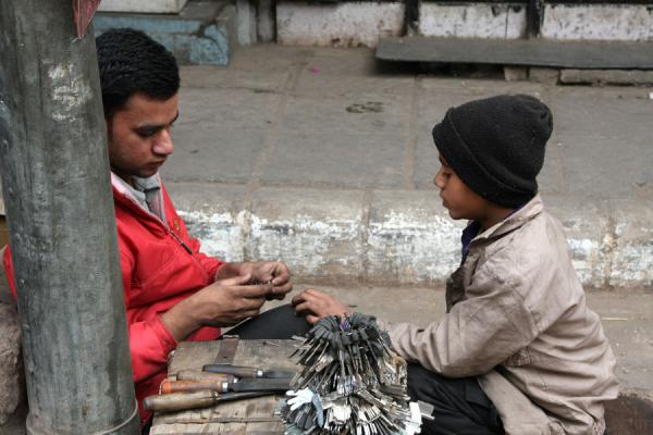 Key maker and boy in the street | Chawri Bazaar | India