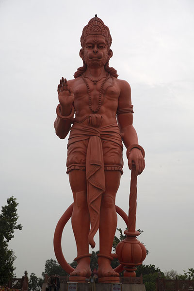 Picture of Hanuman statue towering high above visitors to Chhatarpur temple complex