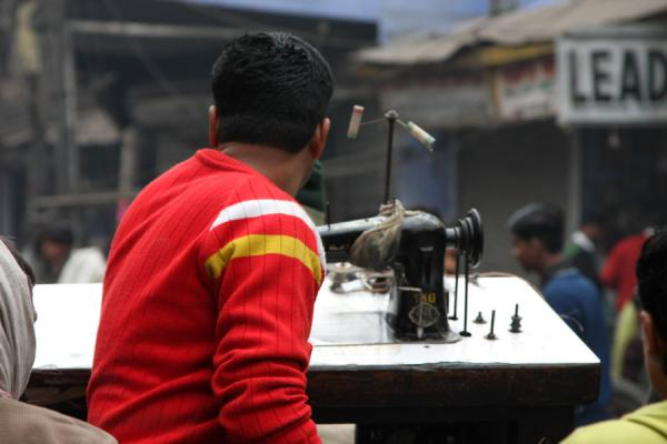 Picture of Cycle rickshaw riders (India): Sewing machine on the back of a bicycle rickshaw