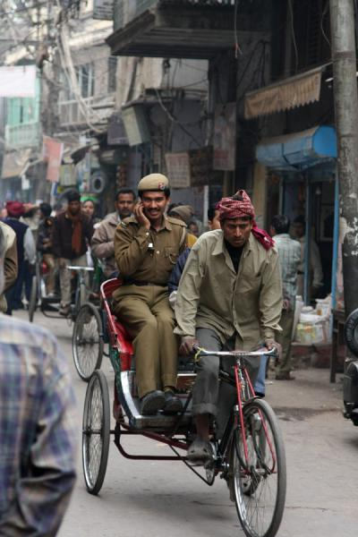 Picture of Cycle rickshaw riders (India): Indian military on a cycle rickshaw