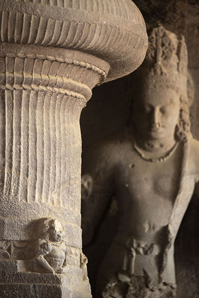 Column with elephant and dvarapala in the background | Elephanta Caves | India