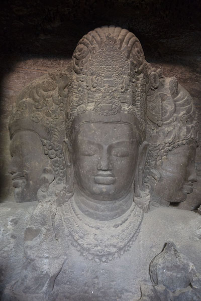 Close-up of Mahesh-Murti-Shiva, a three-faced bust representing Shiva as the Supreme Being | Elephanta Caves | India