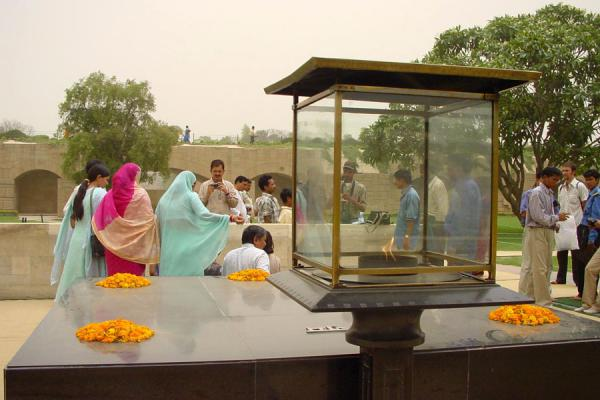 Picture of Gandhi Memorial (India): Family commemorating Gandhi at memorial