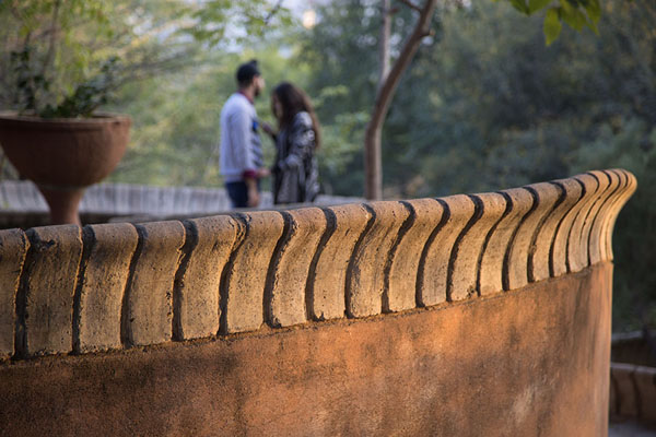 Couple on a balcony | Garden of Five Senses | India
