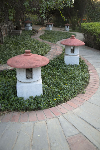 Pathway with mushroom-shaped lanterns | Garden of Five Senses | Inde