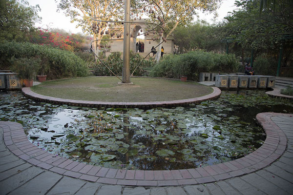 Small pond with a replica of the Jabná Arch | Garden of Five Senses | India