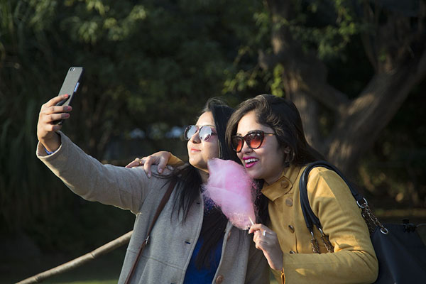 Foto van Indian girls taking a selfie in the Garden of Five SensesDelhi - India
