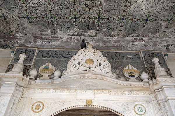 Looking up the decorated entrance to the shrine | Haji Ali Dargah | India