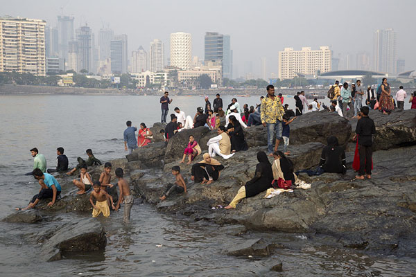 Indians at rising tide with the skyline of Mumbai in the background | Haji Ali Dargah | India
