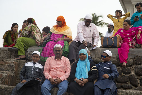 Colourfully dressed Indians resting near the tomb | Haji Ali Dargah | India