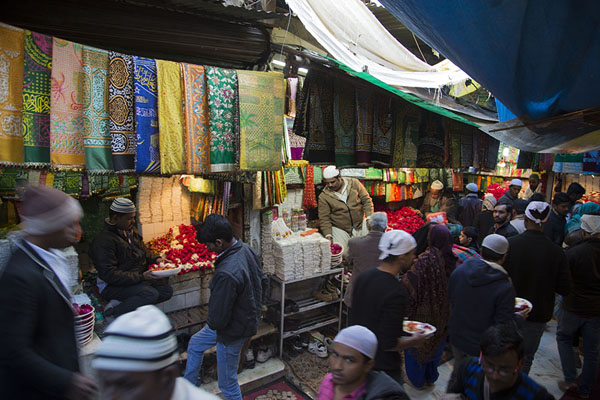 Picture of Shops with colourful clothes and flowers at the entrance to the shrine of Nizamuddin Auliya