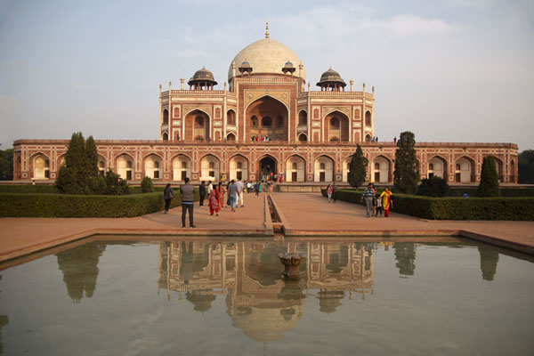 The late afternoon sunlight on Humayun's tomb reflected in a pool | Humayun Tomb | India