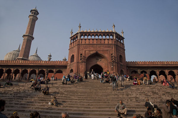 Picture of People sitting on the stairs to the southern entrance to Jama Masjid