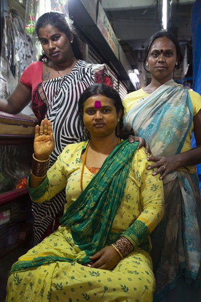 Women posing for a picture at KR market | Mercado Krisharajendra | India