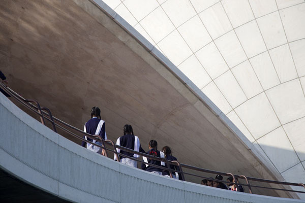 Indian schoolgirls walking under the roof of the Lotus Temple | Lotus Temple | India