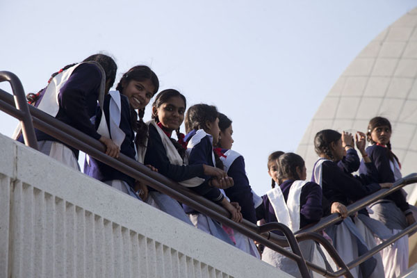 Foto van Indian schoolgirls on their way to the entrance of the Lotus TempleDelhi - India
