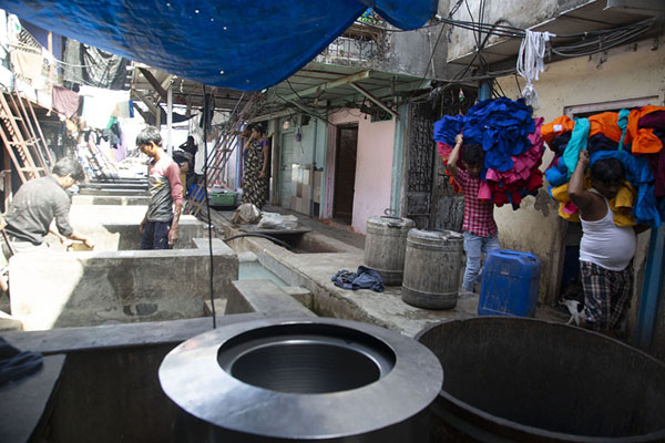 Picture of Two men with laundry bags walking one of the many alleys inside Dhobi GhatMumbai - India