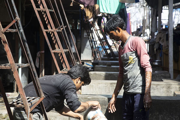 Foto di Two men working in one of the many washing pens in Dhobi GhatMumbai - India