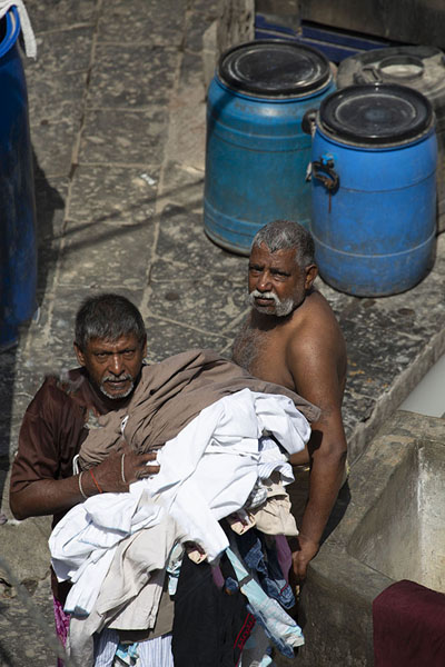 Two men looking up from Dhobi Ghat | Mahalaxmi Dhobi Ghat | India