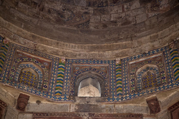 Looking up the central dome with colourful tiled windows | Purana Qila | India