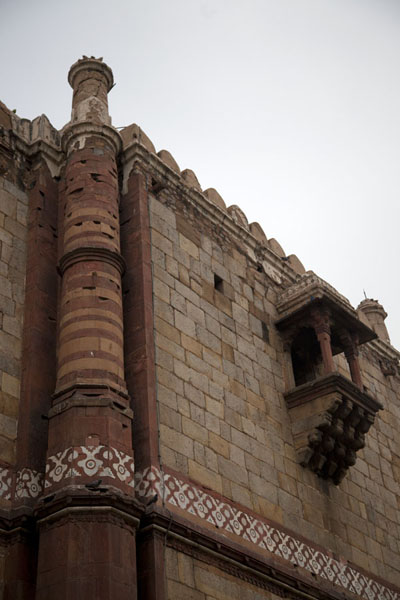 One of the two slender minarets directly attached to the backside of the Qila-i-Kuhna mosque | Purana Qila | India