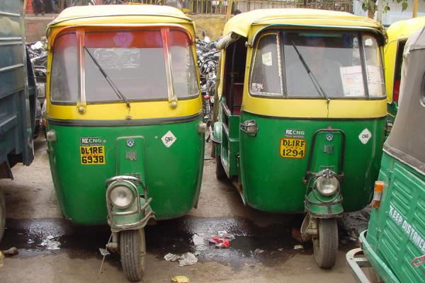 Picture of Delhi rickshaws (India): Two rickshaws waiting in street, New Delhi