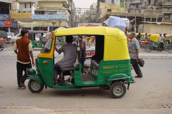 Picture of Delhi rickshaws (India): Rickshaw waiting for a ride, New Delhi