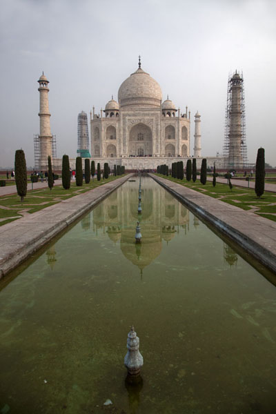 The classic view of the Taj Mahal: the fine marble building reflected in the water | Taj Mahal | India