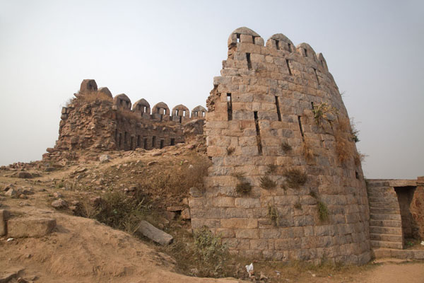 Looking up one of the defensive towers of Tughlaqabad Fort | Tughlaqabad Fort | India