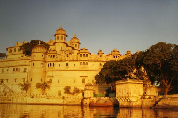 Late afternoon sun reflecting on one of the majestic palaces of Udaipur | Udaipur | India