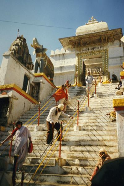 People on the stairs leading to one of the temples of Udaipur | Udaipur | India