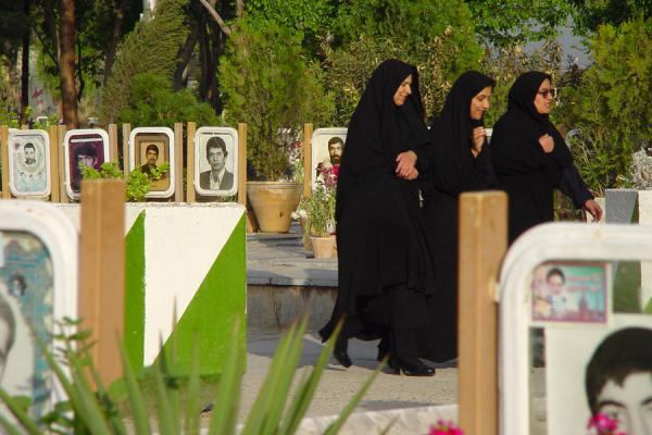 Women walking across the cemetery | Golestan e Shohada | Iran