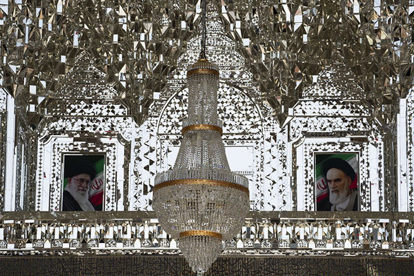 The mirror iwan with chandelier and pictures of ayatollahs at the entrance for women | Hazrat-e Masumeh | Iran