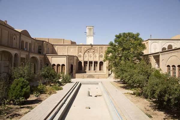 Picture of Central courtyard with empty pool and wind-tower in the background - Iran - Asia