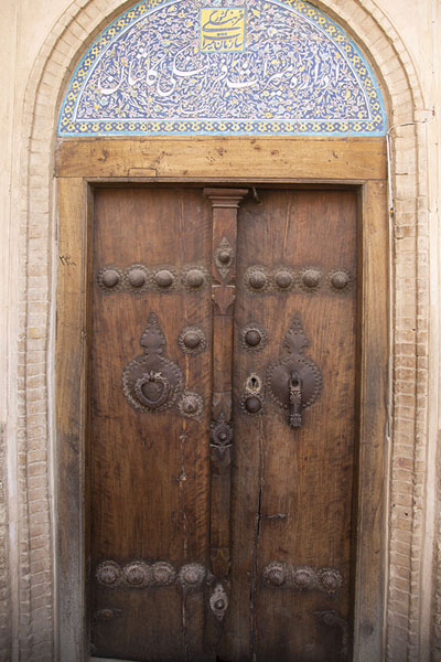 Wooden door with separate knockers for men and women | Khan-e Borujerdi | Iran
