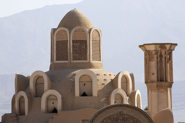 The cupolas of the main building and a wind-tower of Khan-e Borujerdi from a distance | Khan-e Borujerdi | Iran