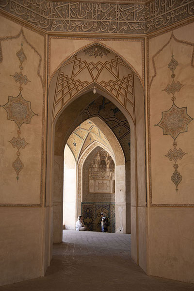 Looking through one of the openings in the main building of the mosque | Masjed-e Agha Bozorg | Iran